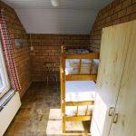 Slaapkamer beneden met stapelbed
